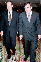 Montreal, 1999-05-30 File Photo. Quebec Premier and leader of the (separatist) Parti Quebecois ;  the Honorable Lucien Bouchard (right) arrives with Gilles Remillard (left) ; the founder and President of the `` Conference of Montreal `` on economy globalization on the opening day of the 5th conference.<br /> Photo :  (c) Pierre Roussel, 1999