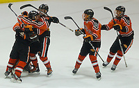 Members of the Bethel Park hockey team, including Joey Scalise #15 and Michael Cure #8, celebrate following their win against Penn-Trafford during their PIHL semifinal game at the Robert Morris University Island Sports Center on Neville Island on March 21, 2012 in Pittsburgh, PA...(Jared Wickerham/For The Tribune-Review).JWPT-Bethel322.jpg.