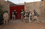 Soldiers from 1st Platoon, Company B, 5th Battalion, 20th Infantry Regiment move into a house to search for weapons and anti-Iraqi forces during Operation Sykes Hammer on Aug. 1, 2004. Three battalions from the 3rd Brigade, 2nd Infantry Division (Stryker Brigade Combat Team) and three Iraqi National Guard battalions conducted Sykes Hammer in an effort to eliminate terrorist activity in the Tall Afar area. (U.S. Army photo by Sgt. Fred Minnick)