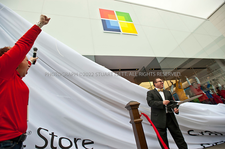 10/20/2011--Seattle, WA, USA...Microsoft store manager Melinda George cheers while MSFT Corporate VP Rich Kaplan cuts the ribbon opening the company's new store...Microsoft (MSFT) opened their 12th retail store in Seattle's U-Village shopping center today. Nearly 1000  people waited in line for the opening of the company's first store in Seattle. The store opened up directly across from an Apple store. Nationwide, Microsoft will open two more this fall, in California and Virginia. ..©2011 Stuart Isett. All rights reserved.