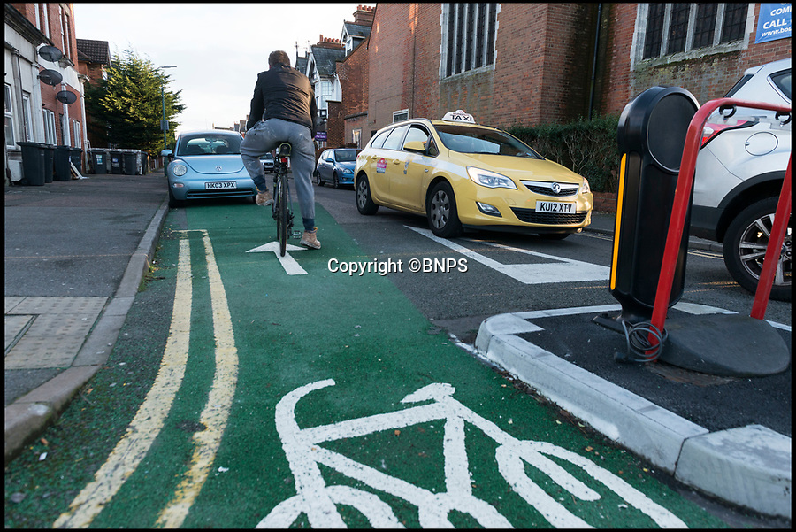 BNPS.co.uk (01202 558833)Pic: LeeMcLean/BNPS<br /> <br /> The bizarre cycle lane in Bournemouth which sends cyclists the wrong way into oncoming traffic.<br /> <br /> A council has been slammed for introducing a 'dreadful' and 'dangerous' cycle lane which puts cyclists at risk of a head-on collision with oncoming traffic.<br /> <br /> The cycle lane in Bournemouth, Dorset, sends cyclists the wrong way up a narrow one way street into the path of oncoming cars. <br /> <br /> It inexplicably ends just metres into the road with cyclists confronted by a row of legally parked cars.<br /> <br /> To avoid them, they either have to pedal into oncoming traffic or risk being 'car-doored', knocked down by a passenger opening the door of their parked car.