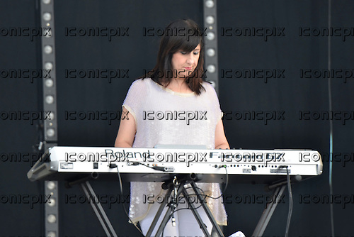 NEW ORDER - keyboard player GILLIAN GILBERT - performing live at BT London Live 2012 Olympic Concert held in Hyde Park London UK - 12 Aug 2012.  Photo credit: George Chin/IconicPix