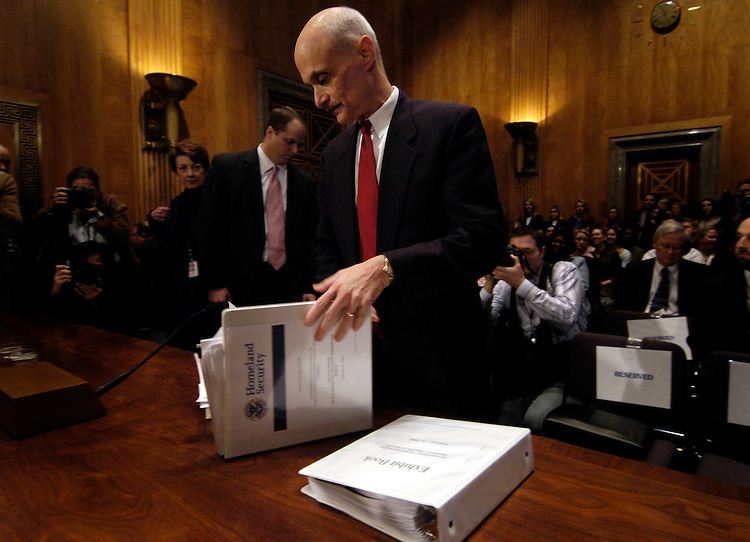 "Homeland Security Secretary Michael Chertoff prepares to testify at a Senate Homeland and Security Governmental Affairs committee hearing on ""Hurricane Katrina: The Homeland Security Department's Preparation and Response."""