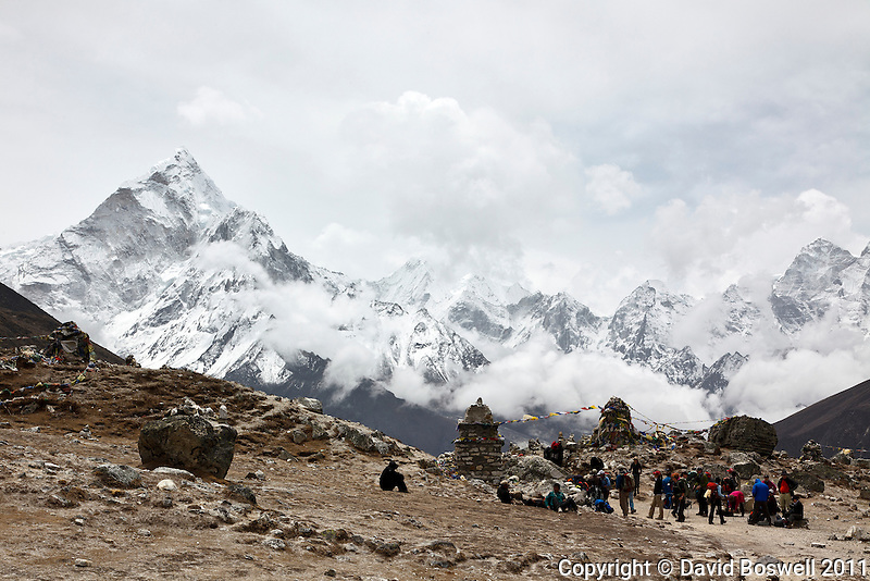 Trekkers in Thokla Pass (16,000 ft./4830 m.) below Lobuche in the Khumbu Valley, Nepal.  Thokla Pass is filled with memorial chortens to fallen climbers from Everest and the surrounding peaks, including Scott Fischer's memorial.
