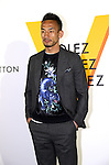 """April 21, 2016, Tokyo, Japan - Former Japanese football star player Hidetoshi Nakata smiles during a photo call for the reception of Louis Vuitton's art exhibition in Tokyo on Thursday, April 21, 2016. French luxury barnd Luis Vuitton will hold the exhibition """"Volez, Voguez, Voyagez"""" in Tokyo from April 23 through June 19.  (Photo by Yoshio Tsunoda/AFLO) LWX -ytd-"""