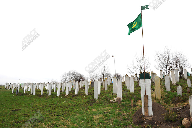 In a cemetery in Nazran, Ingushetia, a recent grave was marked with a tall pole and green flag, traditionally used to indicate that the man had been killed in battle. April 7, 2010