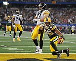 Green Bay Packers receiver Greg Jennings scores a touchdown near Pittsburgh Steelers' Troy Polamalu during the second quarter of Super Bowl XLV at Cowboys Stadium in Arlington, Texas on Feb. 6, 2011.
