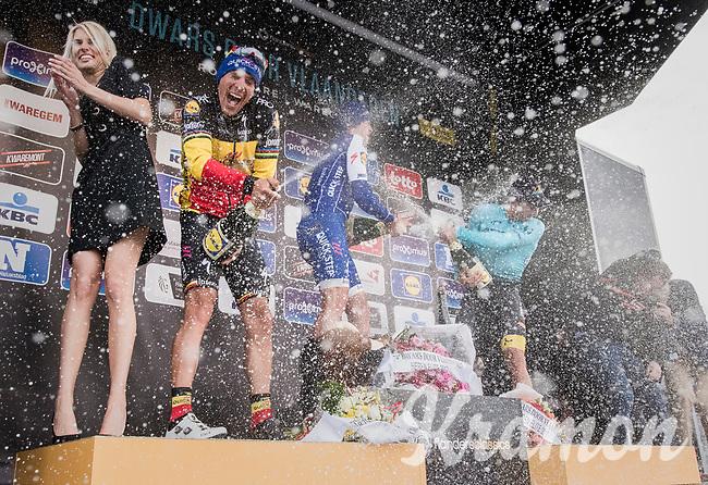 Champaign shower for winner Yves Lampaert (BEL/QuickStep Floors), Philippe Gilbert (BEL/Quick Step floors) & Alexey Lutsenko (KAZ/Astana) on the podium<br /> <br /> 72nd Dwars Door Vlaanderen (1.UWT)<br /> 1day race: Roeselare › Waregem BEL (203.4km)