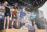 Champaign shower for winner Yves Lampaert (BEL/QuickStep Floors), Philippe Gilbert (BEL/Quick Step floors) & Alexey Lutsenko (KAZ/Astana) on the podium<br /> <br /> 72nd Dwars Door Vlaanderen (1.UWT)<br /> 1day race: Roeselare › Waregem BEL (203.4km)