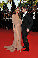 ANGELINA JOLIE &amp; BRAD PITT<br /> The &quot;Inglourious Basterds&quot; Premiere at the Grand Theatre Lumiere during the 62nd Annual Cannes Film Festival, Cannes, France.<br /> May 20th, 2009<br /> full length black tuxedo suit cream beige brown pink dress sheer long wrap couple slit split low cut neckline thigh profile<br /> CAP/PL<br /> &copy;Phil Loftus/Capital Pictures /MediaPunch ***NORTH AND SOUTH AMERICAS ONLY***