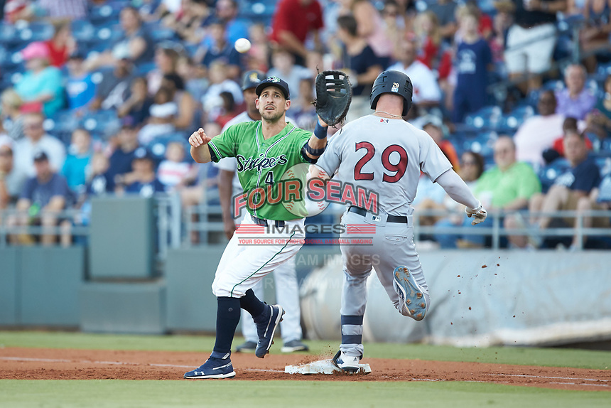 Gwinnett Stripers first baseman Sean Kazmar Jr. (4) reaches for a throw as Trey Amburgey (29) of the Scranton/Wilkes-Barre RailRiders steps on first base at BB&T BallPark on August 16, 2019 in Lawrenceville, Georgia. The Stripers defeated the RailRiders 5-2. (Brian Westerholt/Four Seam Images)
