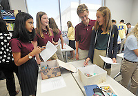 NWA Democrat-Gazette/MICHAEL WOODS &bull; @NWAMICHAELW<br /> Haas Hall Academy students Rumaanah Sharif (from left) Emma Cheatham, Gabe Lovatt-Sutton and Caroline Crank, talk as they critique each others projects during a class activity Friday August 7, 2015, at the new Bentonville campus.  Classes at the new Bentonville campus started Thursday.