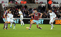 Pictured: Andy Carroll of West Ham (C), Nathan Dyer of Swansea (2nd L) and Ashley Williams (R) Saturday 10 January 2015<br />