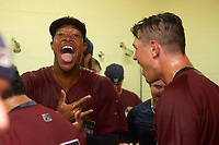 Mahoning Valley Scrappers Will Benson and Nolan Jones celebrate in the locker room after winning the division title during the second game of a doubleheader against the Batavia Muckdogs on September 4, 2017 at Dwyer Stadium in Batavia, New York.  Mahoning Valley defeated Batavia 6-2 to clinch the Pinckney Division Title.  (Mike Janes/Four Seam Images)