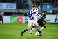 VOETBAL: HEERENVEEN: Abe Lenstra Stadion, SC Heerenveen - Vitesse, 21-01-2012, Eindstand 1-1, Filip Djuricic (#11), Anthony Annan (#20), ©foto Martin de Jong