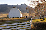 old white barn on working ranch with sunrise and bridger mountain range in background, ross peak, off Springhill Rd., Bozeman Montana.