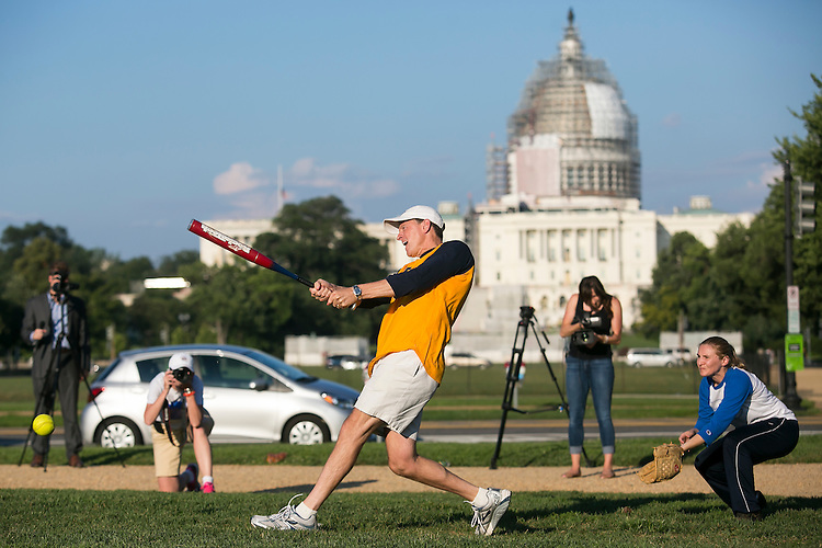 UNITED STATES - JULY 21: Sen. Pat Toomey, R-Penn., swings at the ball during the fifth annual Keystone Cup softball game between the congressional offices of Sen. Bob Casey, D-Penn., and Sen. Pat Toomey, R-Penn., on the National Mall on Tuesday, July 21, 2015. The office of Sen. Pat Toomey won 19-7. (Photo By Al Drago/CQ Roll Call)