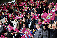 Burnley fans wave flags as they welcome the teams onto the pitch<br /> <br /> Photographer Rich Linley/CameraSport<br /> <br /> The Premier League - Saturday 13th April 2019 - Burnley v Cardiff City - Turf Moor - Burnley<br /> <br /> World Copyright © 2019 CameraSport. All rights reserved. 43 Linden Ave. Countesthorpe. Leicester. England. LE8 5PG - Tel: +44 (0) 116 277 4147 - admin@camerasport.com - www.camerasport.com