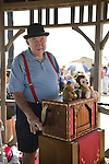Brooklyn, New York, U.S. - August 9, 2014 - Organ grinder BILL SHARKEY plays his 20 note Jager & Brommer organ on the Boardwalk at the Fourth Annual History Day at Deno's Wonder Wheel Amusement Park and The Coney Island History Project, which had family fun music, history, and entertainment at historic Coney Island. Sharkey is a member of AMICA, Automatic Musical Instrument Collectors' Association.
