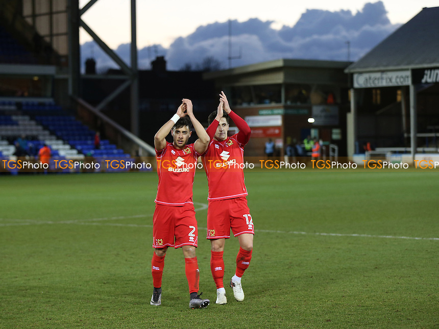 George Baldock and George Williams of MK Dons applaud the away fans at the end of the match during Peterborough United vs MK Dons, Sky Bet EFL League 1 Football at London Road on 28th January 2017