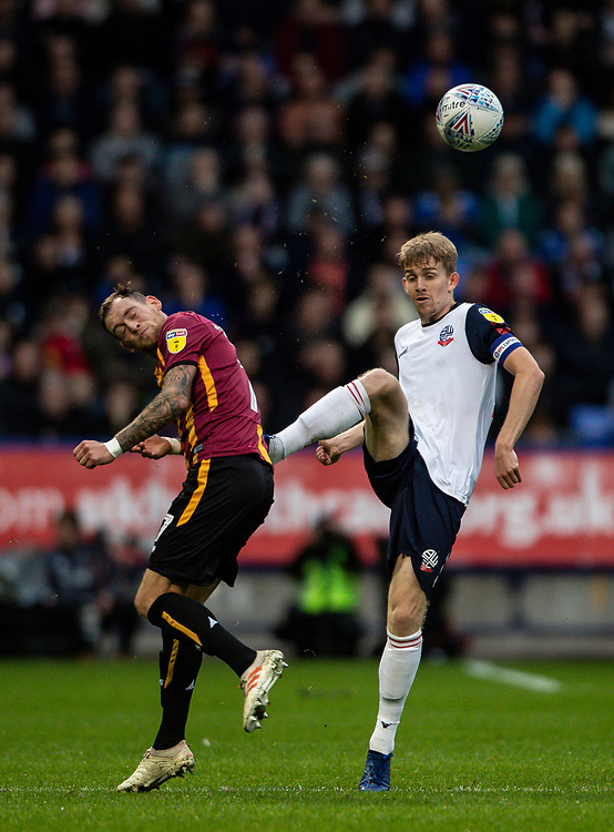 Bolton Wanderers' Harry Brockbank (right) competing with Bradford City's Harry Pritchard <br /> <br /> Photographer Andrew Kearns/CameraSport<br /> <br /> EFL Leasing.com Trophy - Northern Section - Group F - Bolton Wanderers v Bradford City -  Tuesday 3rd September 2019 - University of Bolton Stadium - Bolton<br />  <br /> World Copyright © 2018 CameraSport. All rights reserved. 43 Linden Ave. Countesthorpe. Leicester. England. LE8 5PG - Tel: +44 (0) 116 277 4147 - admin@camerasport.com - www.camerasport.com