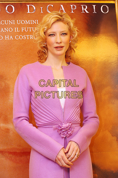 "CATE BLANCHETT.Photocall for ""The Aviator"".Hotel Hassler, Rome, Italy, January 4th 2004.                      .half length pink dress coat jacket zip flower belt kate blanchet.Ref: LC.www.capitalpictures.com.sales@capitalpictures.com.©Luca Cavallari/Capital Pictures ."