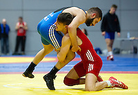 11 MAY 2014 - SHEFFIELD, GBR - George Ramm (bottom) attempts to lift Adam Vella during their men's 60kg category freestyle match at the British 2014 Senior Wrestling Championships in EIS in Sheffield, Great Britain (PHOTO COPYRIGHT © 2014 NIGEL FARROW, ALL RIGHTS RESERVED)