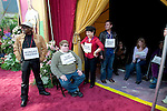 Stand-ins wearing movie star's names waiting to be positioned in the actuals star's places on the red carpet..Oscar Preparations in Hollywood at the Kodak Theater..Hollywood, CA USA.2/26/05.Photo by Ted Soqui/Corbis c 2005