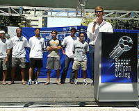 San Jose Earthquakes players look on as general manager Alexi Lalas speaks to a crowd of approximately 1,500 Earthquakes fan gathered at the Soccer Silicon Valley Rally held in downtown San Jose, CA on August 20, 2004 to show support for the club.  The non-profit Soccer Silicon Valley group hope to find a local buyer or soccer specific stadium for the Earthquakes within the next month so the team is not relocated to San Antonio or Houston, TX by its current investor/operator Anschutz Entertainment Group.