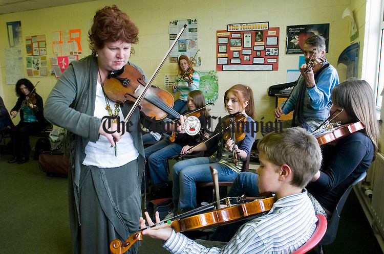 Tutor Bernie Mc Carthy in her fiddle calss at Spanish Point as part of the Willie Clancy Summerschool. Photograph by John Kelly.