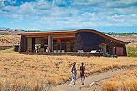 Two visitors walking toward the visitor center at Pu'ukohola Heiau National Historic Site, Kawaihae, Kohala, Big Island.