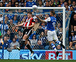 Jack O'Connell of Sheffield Utd heads clear as Steven Fletcher of Sheffield Wednesday waits during the Championship match at the Hillsborough Stadium, Sheffield. Picture date 24th September 2017. Picture credit should read: Simon Bellis/Sportimage