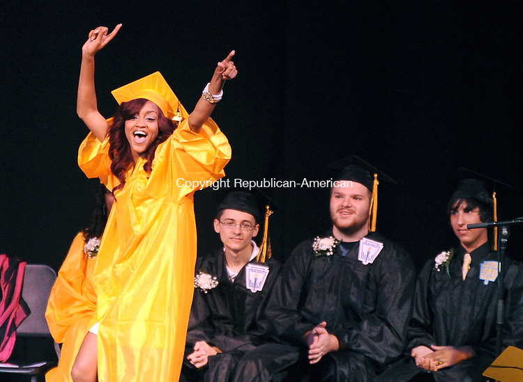 WATERBURY, CT-19 JUNE 2012--061912JS04-Kaynor Tech's Seantavia Williams (Fashion Technology) cheers as she walks across the stage to receive her diploma during graduation ceremonies Tuesday at the Palace Theater in Waterbury.  .Jim Shannon Republican-American