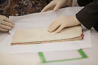 Employees of the Musee de la Civilisation de Quebec Museum unbox the Traite de Paris de 1763 (Treaty of Paris of 1763) before an exhibition in Quebec City, septembre 22 2014. The Treaty of Paris, also known as the Treaty of 1763, was signed on 10 February 1763 by the kingdoms of Great Britain, France and Spain, with Portugal in agreement, after Britain's victory over France and Spain during the Seven Years' War.<br /> <br /> PHOTO :  Francis Vachon - Agence Quebec Presse