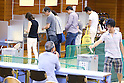 Voters fill out their ballots in Japan's upper house election at a polling station in Tokyo, Japan on July 10, 2016. (Photo by AFLO)