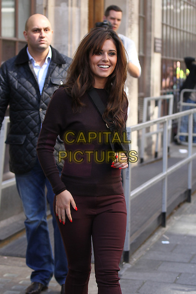 Cheryl Cole at BBC Radio 1, London, England..August 31st, 2012.full length maroon burgundy jumpsuit sling arm injury wound .CAP/HIL.©John Hillcoat/Capital Pictures .