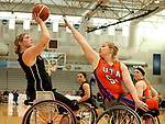 MARSHALL, MN - MARCH 17:  Barbara Gross #23 from Alabama shoots over Rose Hollermann #54 from the University of Texas Arlington during their championship game at the 2018 National Intercollegiate Wheelchair Basketball Tournament at Southwest Minnesota State University in Marshall, MN. (Photo by Dave Eggen/Inertia)