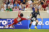 Luka Modric (14) of Tottenham Hotspur F. C. crosses past New York Red Bulls goalkeeper Bouna Coundoul (18). Tottenham Hotspur F. C. defeated the New York Red Bulls 2-1 during a Barclays New York Challenge match at Red Bull Arena in Harrison, NJ, on July 22, 2010.