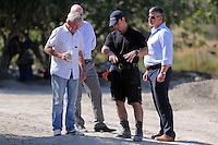 Pictured: Eddie Needham (L), the grandfather of missing Ben Needham with DI Jon Cousins of South Yorkshire Police (2nd L) and other officers in Kos, Greece. Wednesday 05 October 2016<br />