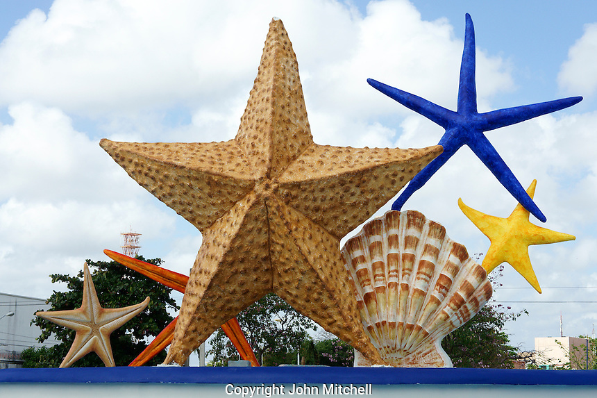 Plaza Caracoles fountain or Ceviche Square, starfish and seashells, corner of Avenida Tulum and Coba, Cancun, Quintana Roo, Mexico.