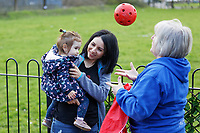 Pictured: A mother holds her daughter while a member of staff entertains her with a  ball. Thursday 21 March 2019<br /> Re: Julie Morgan, AM, has met parents at Twinkle Star playgroup before new legislation is brought in by the Welsh Government to ban parents from smacking children, Cardiff, Wales, UK.