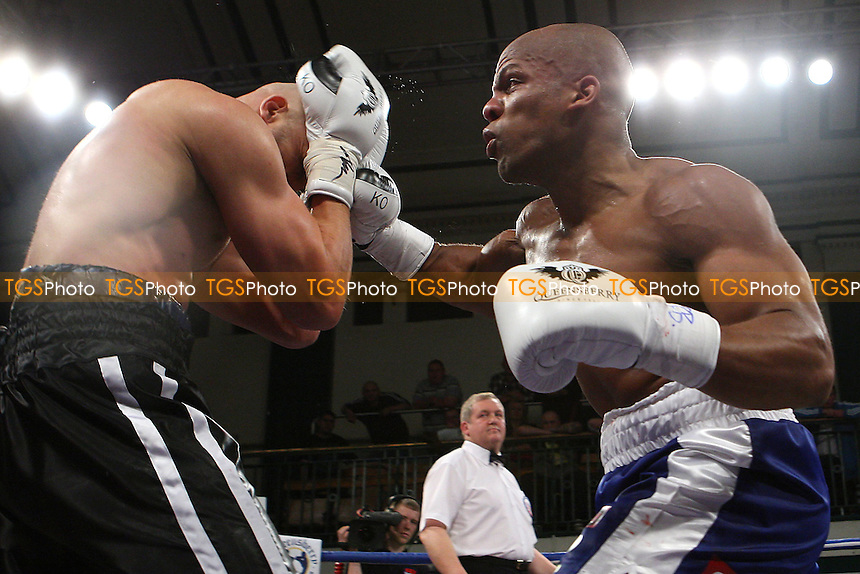 Leon Williams (blue shorts) defeats Rob Norton to win the British Cruiserweight Title at York Hall, Bethnal Green, promoted by Frank Warren - 21/10/11 - MANDATORY CREDIT: Gavin Ellis/TGSPHOTO - Self billing applies where appropriate - 0845 094 6026 - contact@tgsphoto.co.uk - NO UNPAID USE