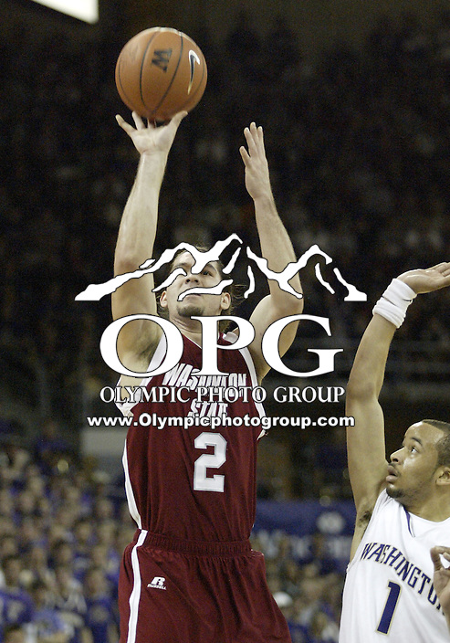 05 January 2008:  Washington State Derrick Low shoots a jumper over Washington's #1 Venoy Overton at Bank of America Arena in Seattle, WA.  Washington State won 56-52 over the Washington Huskies.