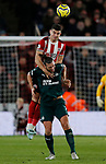 John Egan of Sheffield United climbs above Andy Carroll of Newcastle United to head the ball during the Premier League match at Bramall Lane, Sheffield. Picture date: 5th December 2019. Picture credit should read: James Wilson/Sportimage