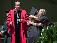 Mathematics professor Nalsey Tinberg hugs her daughter, Mirin Fader during commencement for the Occidental College class of 2013, Sunday, May 19, 2013, Los Angeles, Calif. (Photo by Marc Campos, Occidental College Photographer)