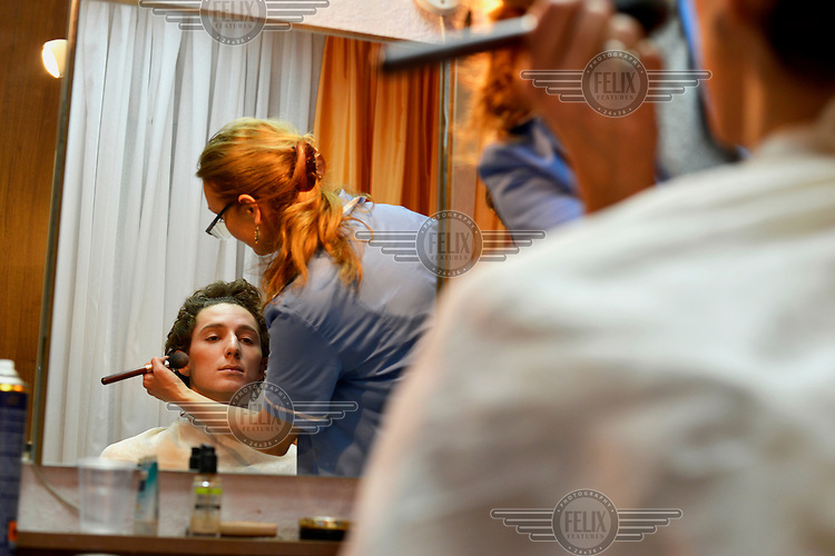 Ballet dancers, most of them graduates from the Moldova State College of Choreography, get made up before a performance of Romeo and Juliet staged at the Chisinau Opera House.