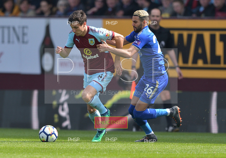 14/04/2018 Premier League Burnley v Leicester City<br /> <br /> Jack Cork challenged by Riyad Mahrez