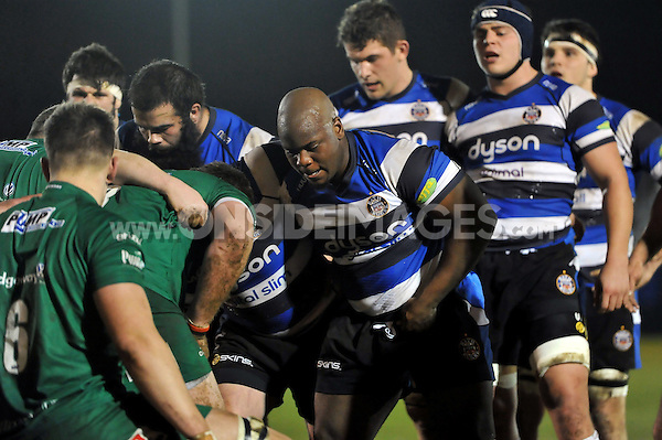 Beno Obano and the rest of the Bath United forwards pack down for a scrum. Aviva A-League match, between Bath United and London Irish A on December 22, 2014 at the Recreation Ground in Bath, England. Photo by: Patrick Khachfe / Onside Images