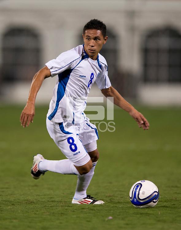 Osael Romero (8) of El Salvador brings the ball up the field at RFK Stadium in Washington, DC.  Jamaica defeated El Salvador, 2-0.