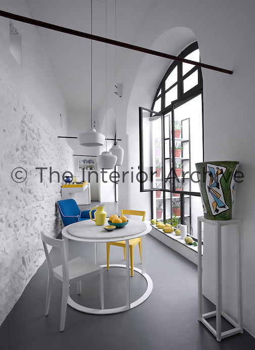 The narrow contemporary kitchen opens onto an enclosed patio
